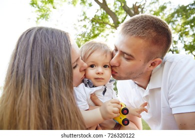 Parents with baby in the park