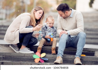 Parents and boy look happy and smile.Happiness and harmony in family life.