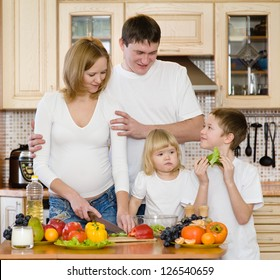 parents with children in kitchen