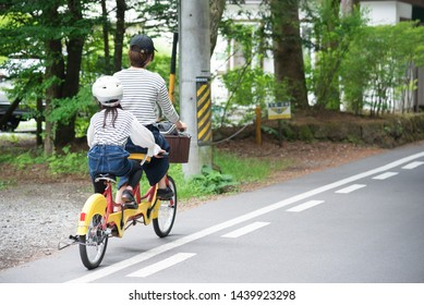 Parents and children riding bicycles in Karuizawa
