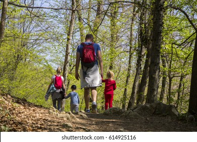 Parents with children walking by hiking trail