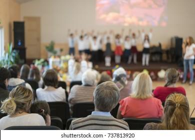 Parents at a concert at children in a kindergarten