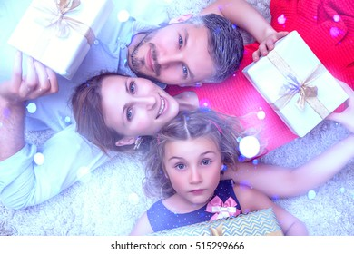 parents with daughter and christmas presents