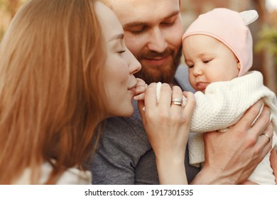 Parents with daughter. Family in a park. Newborn girl.