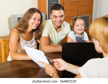 Parents with daughter glad hearing words of social worker at  home