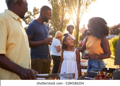 Parents and daughter at a multi generation family barbecue