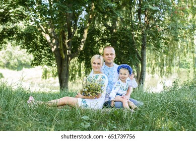 parents and daughter on vacation playing together outdoor