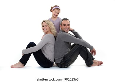 Parents and daughter on white background