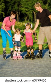 Parents and daughters  in roller skates