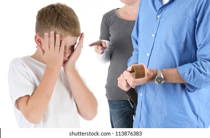 Parents Discipline a Young Boy with Head in Hands
