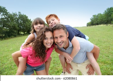 Parents doing piggyback to their children