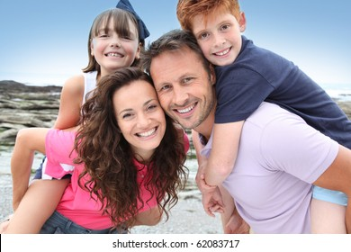 Parents doing piggyback to their children