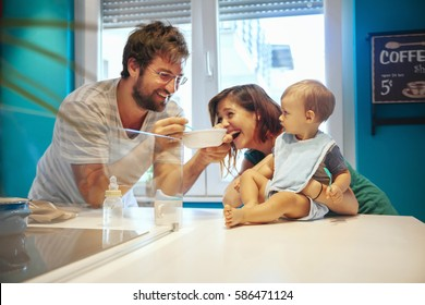 Parents Feeding Their Son