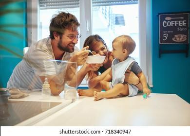 Parents Feeding Their Son