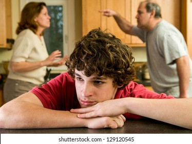 Parents fight, kid suffers: teen boy with tears on cheek
