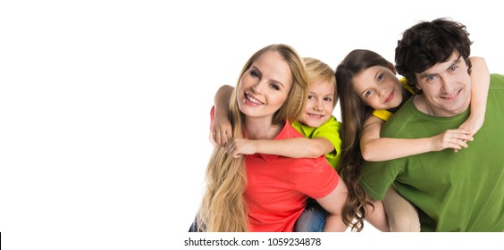 Parents giving piggyback ride to kids, studio isolated on white background
