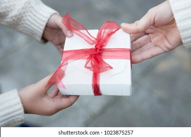 Parents hand over gifts