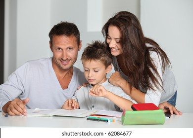 Parents helping son to do his homework