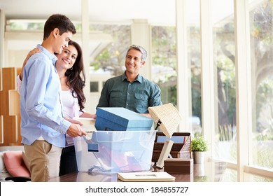 Parents Helping Teenage Son Pack For College