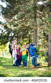 parents hiking with their children in forest