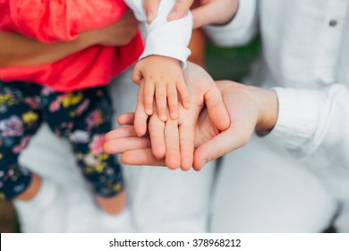 Parents hold child