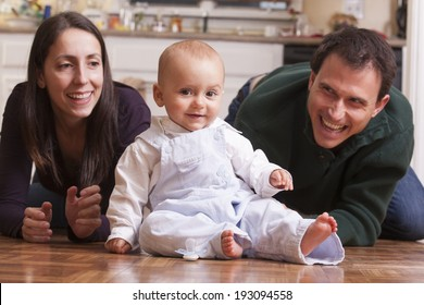 Parents playing on the floor with their son