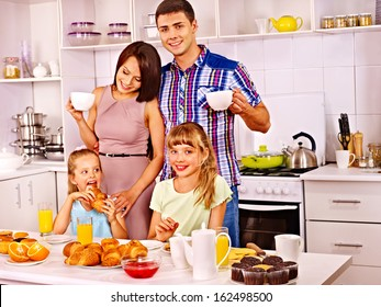 Parents prepare  breakfast for child. Happy family.