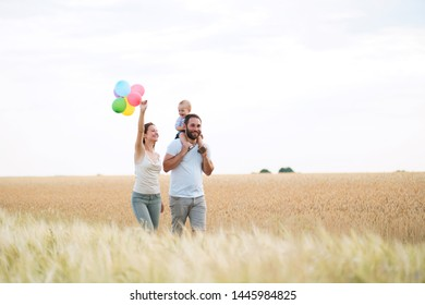 Parents and son family portrait. Daddy, mom and child having fun outdoors