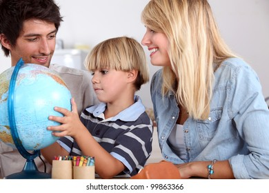 Parents with son and globe