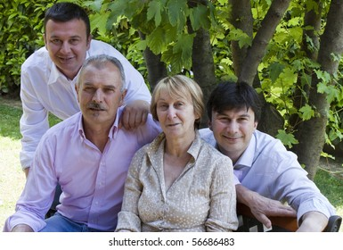 Parents and Sons posing for Family Portrait in the Garden