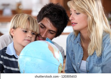 Parents teaching their son about the world