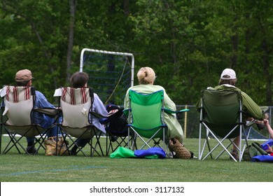 Parents watching soccer game