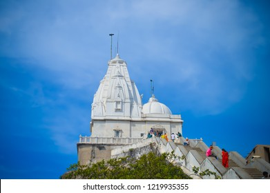 PARESHNATH , JHARKHAND, INDIA - MAY 9 2017: Tourist come See the sacred temple of RANCHI eastern India, Asia. Famous view of beautiful white marble architecture of popular Jain temple..