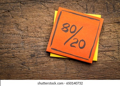 Pareto principle or eighty-twenty rule represented on a sticky note against rustic wood - a reminder or advice