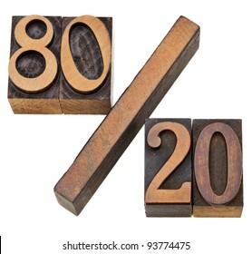 Pareto principle or eighty-twenty rule represented on isolated vintage wood letterpress printing blocks