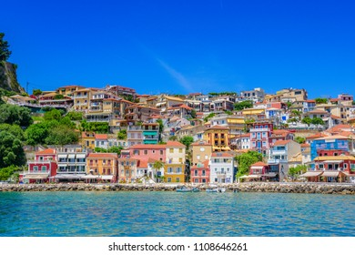 PARGA, GREECE - MAY 2018: Amazing view from the coastal city of Parga with beautiful architectural buildings, decorated shops, and restaurants. Parga, Epirus, Greece, Europe.