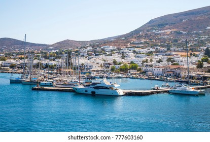 Parikia, Greece - September 02,  2017: Parikia town and marina with yachts and boats , view from the sea, Paros island, Cyclades, Greece