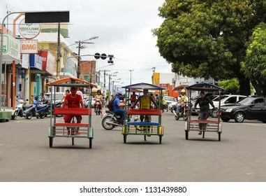 PARINTINS, BRAZIL-APR. 12, 2011:  Taxi service by trishaw in this city along Brazil's Amazon River.
