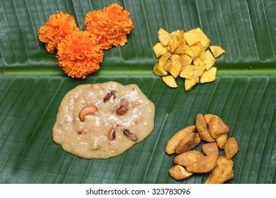 Parippu Payasam severd on  a plaintain leaf with banana chips, sharkara upperi and banana. dal, coconut milk, jaggery, ghee,rasins. Traditional Onam Sadhya Kerala, India dussehra dasara diwali