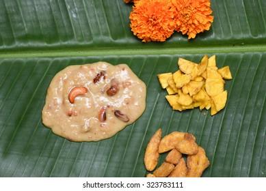 Parippu Payasam severd on  a plaintain leaf with banana chips, sharkara upperi and banana.Prepared using dal, coconut milk, jaggery, ghee,rasins and cashewnut. Traditional Onam Sadhya Kerala, India
