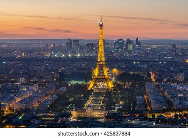 PARIS - 19 SEPTEMBER: Eiffel Tower brightly illuminated at dusk on May 22, 2008 in Paris. The Eiffel tower is the most visited monument of France