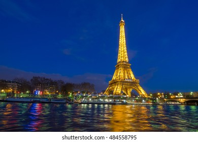 PARIS -APR 7: Eiffel Tower in the Dusk on April 7, 2016. The Eiffel tower is the most visited monument of France.