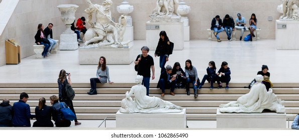 PARIS - APRIL 2, 2018: Unidentified people visit Louvre, the world's largest art museum and a historic monument in Paris, France