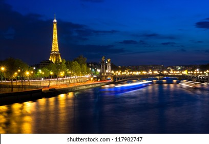 PARIS - APRIL 24: Cityscape of Paris with Eiffel Tower at night on April 24, 2012. The Eiffel tower is the most visited monument of France with about 6 million visitors every year.