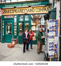 PARIS - APRIL 29, 2016: Tourists outside the famous Shakespeare and Company bookstore in the Latin Quarter.
