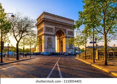 Paris Arc de Triomphe (Triumphal Arch) in Chaps Elysees at sunset, Paris, France. Architecture and landmark of Paris. Sunset Paris cityscape