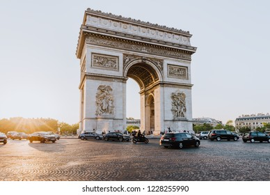 Paris Arc de Triomphe (Triumphal Arch) in Chaps Elysees at sunset, Paris, France.