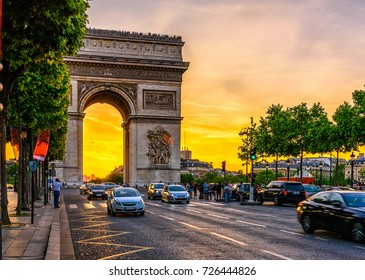 Paris Arc de Triomphe (Triumphal Arch) in Chaps Elysees at sunset, Paris, France. Architecture and landmarks of Paris. Postcard of Paris
