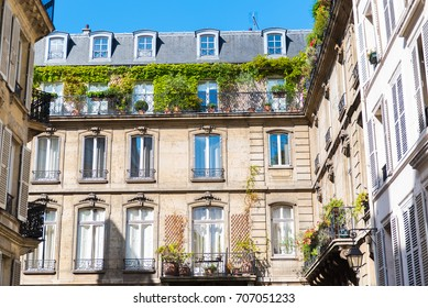 Paris, attractive facades in the Marais, with geometry of the windows, charming typical building