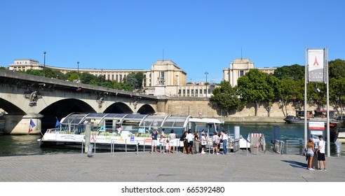 PARIS - AUG 13:  Tourists wait to board a Batobus in Paris, France on August 13, 2016.  It is a shuttle service on the Seine river.